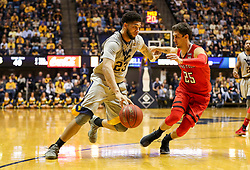 Feb 26, 2018; Morgantown, WV, USA; West Virginia Mountaineers forward Esa Ahmad (23) drives baseline while guarded by Texas Tech Red Raiders guard Davide Moretti (25) during the second half at WVU Coliseum. Mandatory Credit: Ben Queen-USA TODAY Sports