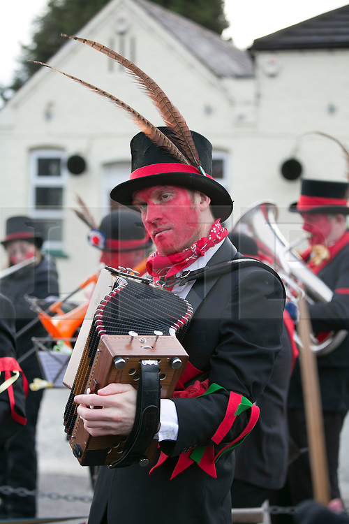 """© Licensed to London News Pictures.10/1/2015.Sharnford, Leicestershire, UK. The annual plough tour by the Hinckley Bullockers took place today. Pictured, dancing outside the Countrymam Public House in Sharnford. Visiting seven venues around Leicestershire the Bullockers, some with with red painted faces, are seen pulling their decorated plough along the street before stopping to perform traditional dances.<br /> <br /> HISTORY -  On the first Monday after Twelfth Night - Plough Monday - the plough was prepared for the new season, dressed in gaudy ribbons and taken in procession around the villages. In South West Leicestershire the men pulling the plough, who """"raddled"""" their faces, were known as Plough Bullocks and were aided and abetted by dancers who danced dances peculiar to the Eastern Counties. The Plough Bullocks and the Molly Dancers were last seen in this area at the turn of the century in Sapcote.<br />  Traditionally, the Plough Bullockers would stop at public houses, farms and large houses, dance and/or sing and demand recognition in the form of cash donations or drink. If neither was forthcoming the offending landlord's drive was ploughed up. Photo credit : Dave Warren/LNP"""
