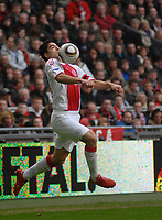 Amsterdam The Netherlands 14 March 2010: Eredivisie game Ajax vs PSV Eindhoven. Uruguay international Luis Suarez chests the ball for Ajax. The home team win 4-1 so closing the gap on second placed PSV. 14/03/20010. Credit Richard Wareham\ Colorsport