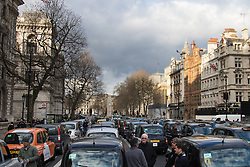 Whitehall, London, February 10th 2016. Hundreds of taxis jam Whitehall as an estimated 8,000 cabbies hold a go-slow in protest against what they say is unfair competition from minicab and Uber drivers who do not have to undergo the rigorous training and checks required for the licenced taxi trade. ///FOR LICENCING CONTACT: paul@pauldaveycreative.co.uk TEL:+44 (0) 7966 016 296 or +44 (0) 20 8969 6875. ©2015 Paul R Davey. All rights reserved.