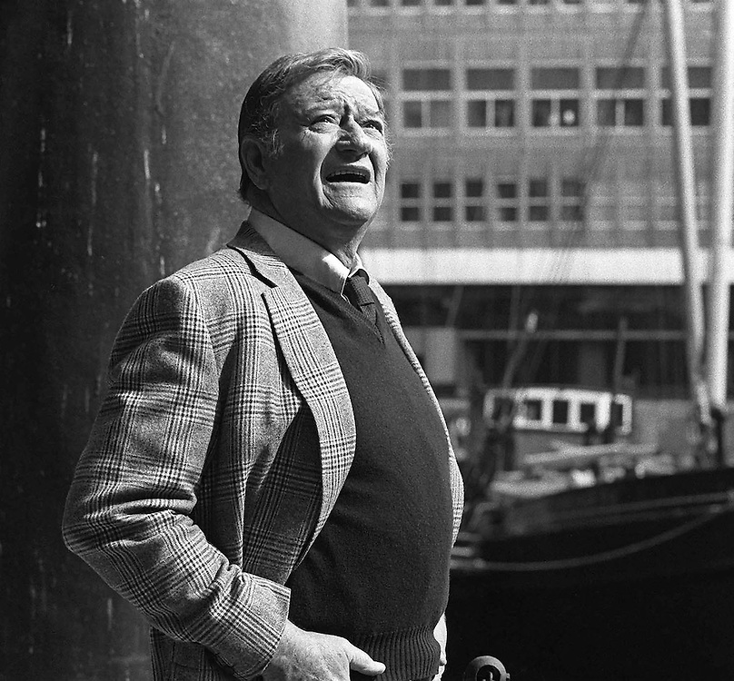 American actor John Wayne seen in London during the filming of 'Branigan' in 1974. Photographed by Terry Fincher