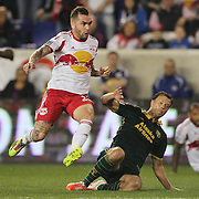 Jonny Steele, (left), New york Reds Bulls, shoots past Jack Jewsbury, Portland Timbers, during the New York Red Bulls Vs Portland Timbers, Major League Soccer regular season match at Red Bull Arena, Harrison, New Jersey. USA. 24th May 2014. Photo Tim Clayton