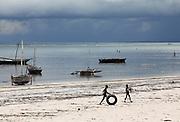 Children play on the beach in Matwemwe, Zanzibar.
