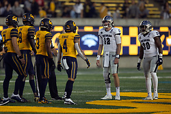 California captains Chase Garbers (7), Kuony Deng (8), Elijah Hicks (3) and Nikko Remigio (4) meet their Nevada counterparts -- Carson Strong (12) and Lawson Hall (30) before an NCAA college football game, Saturday, Sept. 4, 2021, in Berkeley, Calif. (AP Photo/D. Ross Cameron)