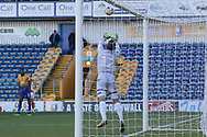 Robert Olejnik of Mansfield Town (12) claims a cross during the The FA Cup match between Mansfield Town and Charlton Athletic at the One Call Stadium, Mansfield, England on 11 November 2018.