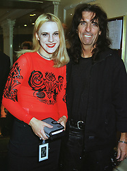 MISS CALICO COOPER and her father rock singer ALICE COOPER, at a luncheon in London on 25th June 1999.MTT 7