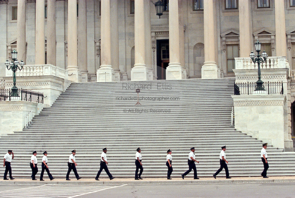 US Capitol Police walk past the US Capitol after a shooting erupted on Capitol Hill July 24, 1998 in Washington, DC. Two US Capitol police officers were killed in the incident, one person wounded and the lone gunmen was wounded and taken into custody.