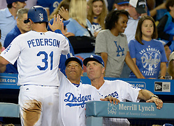 July 28, 2017 - Los Angeles, California, U.S. - Los Angeles Dodgers' Joc Pederson (31) high fives manager Dave Roberts, center, and bench coach Bob Geren after scoring on a double by teammate Chris Taylor (not pictured) against the San Francisco Giants in the seventh inning of a Major League baseball game at Dodger Stadium on Friday, July 28, 2017 in Los Angeles. (Photo by Keith Birmingham, Pasadena Star-News/SCNG) (Credit Image: © San Gabriel Valley Tribune via ZUMA Wire)