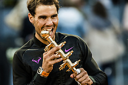 May 14, 2017 - Madrid, Madrid, Spain - RAFAEL NADAL (ESP) bites into the trophy after his victory against Dominic Thiem (AUT) in the final of the 'Mutua Madrid Open' 2017. Nadal won 7:6, 6:4 (Credit Image: © Matthias Oesterle via ZUMA Wire)
