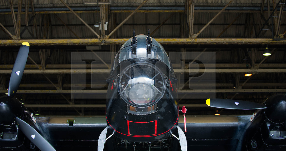 © Licensed to London News Pictures. <br /> 28/08/2014. <br /> <br /> Durham Tees Valley Airport, United Kingdom<br /> <br /> One of only two remaining flying Avro Lancaster bombers is prepared before leaving the hangar to be displayed as it visits Durham Tees Valley airport today. <br /> <br /> The aircraft, 'Mynarski' is named after Pilot Officer Andrew Mynarski who flew with the Canadian Royal Air Force from the airport which was then called RAF Middleton St George.<br /> <br /> Pilot Officer Mynarski was posthumously awarded a VC after giving his life while trying to save a colleague when their Lancaster was shot down in June 1944.<br /> <br /> The famous World War Two aircraft is owned by the Canadian Warplane Heritage Museum and is beginning a 2-week tour of the UK.<br /> <br /> Photo credit : Ian Forsyth/LNP