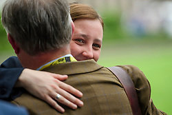 © Licensed to London News Pictures. 12/06/2017. London, UK. MP MHAIRI BLACK hugs another SNP MP before SNP leader NICOLA STURGEON holds a photocall and press conference outside parliament with her newly elected MPs. Over the weekend British prime minister Theresa May formed a new cabinet and continues discussions with the DUP in an attempt to form a new government. Photo credit: Ben Cawthra/LNP