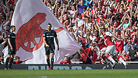 Football - 2017 / 2018 Premier League - Arsenal vs. West Ham United<br /> <br /> Alexandre Lacazette (Arsenal FC) runs off in celebration after scoring as disappointed West Ham players trudge back at The Emirates.<br /> <br /> COLORSPORT/DANIEL BEARHAM