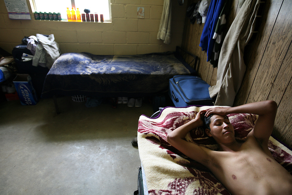 Migrant worker  Luis Aguiar, 25, of Nayarit, Mexico rest in his bedroom after a hard day of working in the fields. Aguiar, who is married and has one son, has worked at the farm for two years.