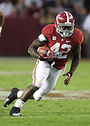 TUSCALOOSA, AL - NOVEMBER 10:  Running back Eddie Lacy #42 of the Alabama Crimson Tide runs with the ball during the game against the Texas A&M Aggies at Bryant-Denny Stadium on November 10, 2012 in Tuscaloosa, Alabama.  (Photo by Mike Zarrilli/Getty Images)