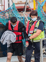 © Licensed to London News Pictures. 18/10/2021. DOVER, UK. Migrants arriving at Dover docks again today whilst weather conditions are still good, the sea is calm and before the weather changes for winter. Photo credit: Stuart Brock/LNP