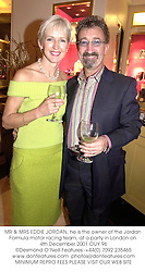 MR & MRS EDDIE JORDAN, he is the owner of the Jordan Formula motor racing team, at a party in London on 4th December 2001.	OUY 96
