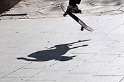 Bolivia June 2013. La Paz. Plaza Avaroa. Skateboarder and shadow.