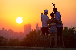 ©Licensed to London News Pictures 25/06/2020<br /> Greenwich, UK. A sunset view from Greenwich park, Greenwich,London. The sun sets over London tonight after the second consecutive hottest day of the year as the heatwave continues in the UK. Photo credit: Grant Falvey/LNP