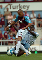 Photo: Tony Oudot. <br /> West Ham United v Manchester City. Barclays Premiership. 11/08/2007. <br /> Bobby Zamora of West Ham is tackled by Micah Richards of Manchester City