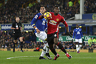 Paul Pogba of Manchester United gets in front of Ramiro Funes Mori of Everton. Premier league match, Everton v Manchester United at Goodison Park in Liverpool, Merseyside on Sunday 4th December 2016.<br /> pic by Chris Stading, Andrew Orchard sports photography.