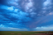 A blue sky fills with rain clouds in Texas.