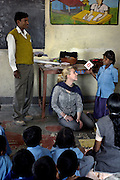 A young school girl learns the alphabet at the Purvaiachal dalit Balika school in Ghazipur district
