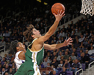 William & Mary guard David Schneider (C) drives to the basket past Kansas State guard Blake Young (L) in the first half at Bramlage Coliseum in Manhattan, Kansas, November 11, 2006.  K-State defeated the Tribe 70-60.<br />