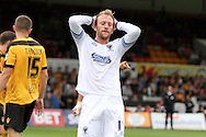 Sean Rigg of Wimbledon reacts after a missed chance. Skybet football league two match, Newport county v AFC Wimbledon at Rodney Parade in Newport, South Wales on Saturday 27th Sept 2014<br /> pic by Mark Hawkins, Andrew Orchard sports photography.