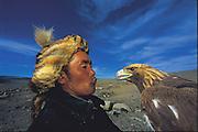 Kazakh Hunter with Golden Eagle<br /> Aquila chrysaetos<br /> Western Mongolia