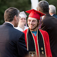 Brian Connelly congratulates Joshua Paul Longfellow after receiving his diploma during the 133rd Commencement at Laconia High School Friday evening.  (Karen Bobotas/for the Laconia Daily Sun)Laconia High School commencement ceremony June 10, 2011.