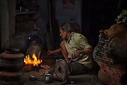 Metalworker in a back alley forge on the 20th January 2018 in the city of Udaipur, India.