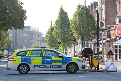 © Licensed to London News Pictures.  22/09/2021. London, UK. Police guard a crime scene after a man was fatally shot in Wood Green, north London. Police were called to Greens Lane last night, 21 September, following reports of a person being shot. The male was pronounced dead at the scene. Photo credit: Marcin Nowak/LNP