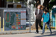 Students walk past a sign at Antioch High School on Tuesday, June 5, 2012 highlighting improvements called for in Measure J. Measure J is a $59.5 million school bond which will allow the District to rebuild Antioch High School.   (Photo by Kevin Bartram)