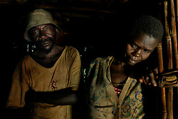 Cosmos Mbawala stands with his wife Halima inside their hut where they stood when they heard the screams of their son, Cosmos Chakoma, 12, after he was killed by a lion in Hingawali village near Lindi, Tanzania. Cosmos, 12,  had just gone to see a lion that was killed in a nearby village that villagers had thought was responsible for killing others earlier in the month when he was attacked by this lion.  (Ami Vitale)