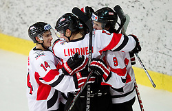 Fabio Hofer,  David Lindner and Markus Pock  of Austria celebrate  during the ice hockey match between National teams of Lithuania (LTU) and Austria (AUT) at 2011 IIHF World U20 Championship Division I - Group B, on December 12, 2010 in Ice skating Arena, Bled, Slovenia.  (Photo By Vid Ponikvar / Sportida.com)