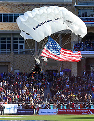 December 23, 2017 - Fort Worth, TX, USA - A paratrooper parchutes into Amon Carter Stadium before the game between San Diego State and Army on Saturday, Dec. 23, 2017, in the Armed Forces Bowl at Amon Carter Stadium in Fort Worth, Texas. (Credit Image: © Steve Nurenberg/TNS via ZUMA Wire)