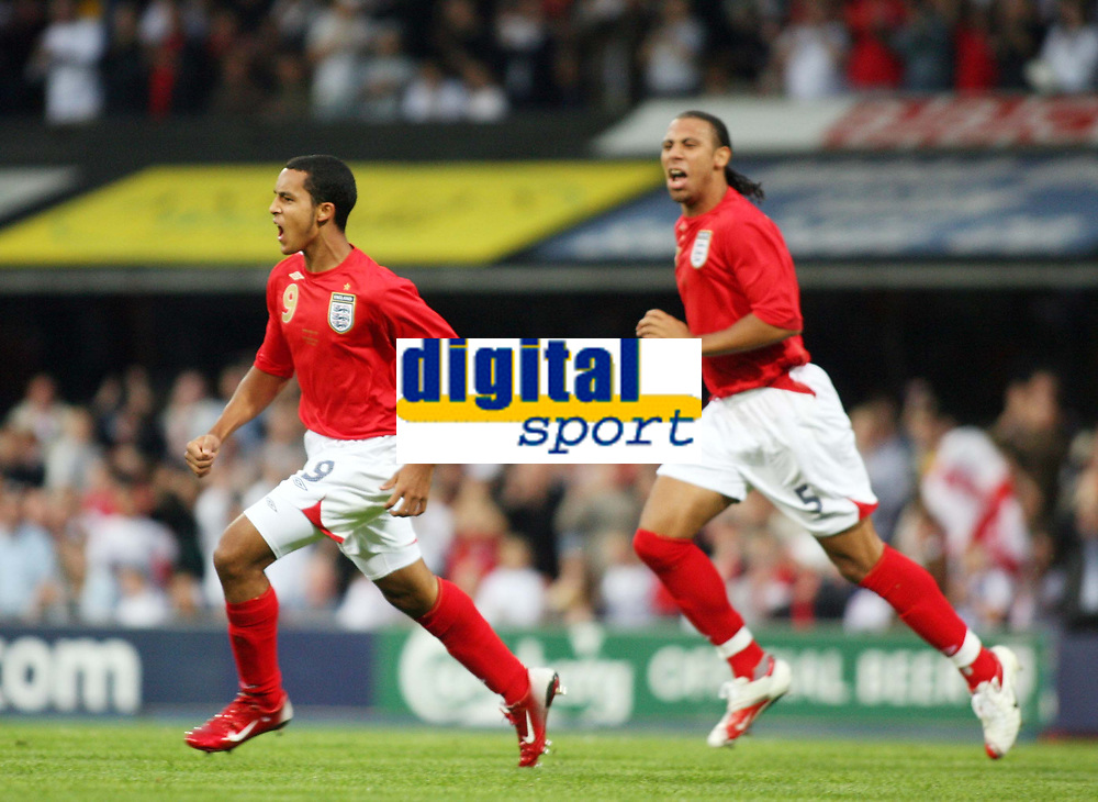 Photo: Chris Ratcliffe.<br /> England U21 v Moldova U21. European Championship Qualifier. 15/08/2006.<br /> Theo Walcott of England U21 celebrates his goal with Anton Ferdinand (R).