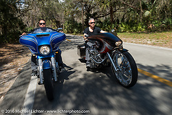Zach Ness riding riding in Tamoka State Park with his father Cory Ness on his side-by-side twin engine custom during the Daytona Bike Week 75th Anniversary event. FL, USA. Monday March 7, 2016.  Photography ©2016 Michael Lichter.