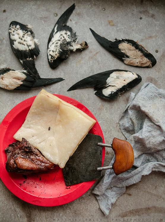 Ptarmigan and seal meat on the menu. At the house of Victoria Mikaelsen. Life in and around the small Inuit settlement of Isortoq (population of 64), in East Greenland.