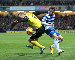 Reading's Adam Le Fondre and Watford's Joel Ekstrand vie for the ball - Photo mandatory by-line: Nigel Pitts-Drake/JMP - Tel: Mobile: 07966 386802 11/01/2014 - SPORT - FOOTBALL - Vicarage Road - Watford - Watford v Reading - Sky Bet Championship