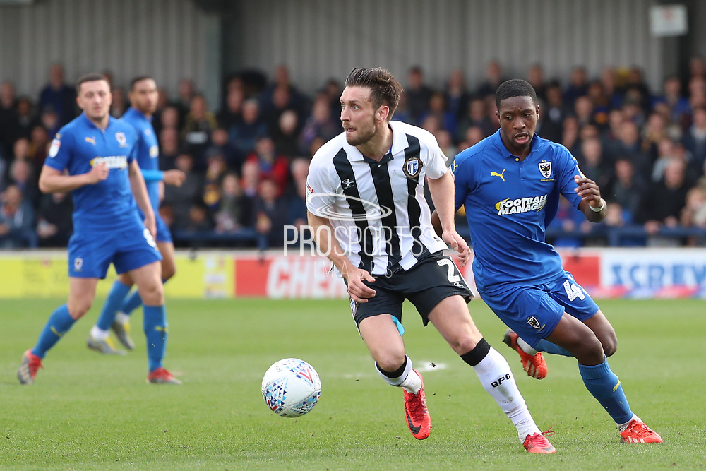 AFC Wimbledon attacker Michael Folivi (41) battles for possession during the EFL Sky Bet League 1 match between AFC Wimbledon and Gillingham at the Cherry Red Records Stadium, Kingston, England on 23 March 2019.