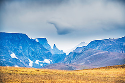 Bears Tooth Peak, the namesake mountain of the Beartooth Range in Montana, as seen here from Wyoming across the chasm. Many views like this can be seen along the Beartooth Highway that connects Red Lodge Montana to Cooke City Montana with a long dogleg south through Wyoming.