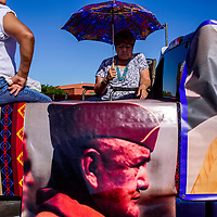 Arlene Hickson rides in a float dedicated to her father Joseph F. Price during the Navajo Code Talker Day parade in Window Rock Monday.