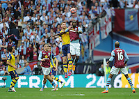Arsenal's Per Mertesacker vies for possession with Aston Villa's Christian Benteke<br /> <br /> Photographer Ashley Crowden/CameraSport<br /> <br /> Football - The FA Cup Final - Aston Villa v Arsenal - Saturday 30th May 2015 - Wembley - London<br /> <br /> © CameraSport - 43 Linden Ave. Countesthorpe. Leicester. England. LE8 5PG - Tel: +44 (0) 116 277 4147 - admin@camerasport.com - www.camerasport.com