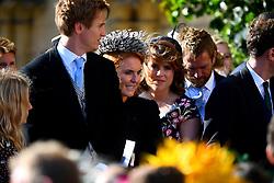Sarah Ferguson the Duchess of York and her daughter Princess Beatrice of York leave York Minster after the wedding of singer Ellie Goulding and Caspar Jopling.