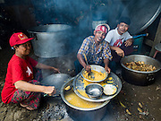 25 OCTOBER 2015 - SHWEPYITHAR, MYANMAR: NLD supporters in Shwepyithar, Myanmar, make lunch for the crowd expected at a NLD rally in the small town about 90 minutes from Yangon. Political parties are in fill campaign mode in Myanmar (Burma). National elections are scheduled for Sunday Nov. 8. The two principal parties are the National League for Democracy (NLD), the party of democracy icon and Nobel Peace Prize winner Aung San Suu Kyi, and the ruling Union Solidarity and Development Party (USDP), led by incumbent President Thein Sein. There are more than 30 parties campaigning for national and local offices.     PHOTO BY JACK KURTZ