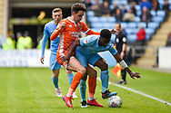 Coventry City defender Brandon Mason (3) battles for possession  with Shrewsbury Town midfielder Alex Gilliead (18) during the EFL Sky Bet League 1 match between Coventry City and Shrewsbury Town at the Ricoh Arena, Coventry, England on 28 April 2019.