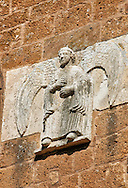 13th century angel sculptures on the facade of the Romanesque Basilica Church of Santa Maria Maggiore, Tuscania .<br /> <br /> Visit our ITALY PHOTO COLLECTION for more   photos of Italy to download or buy as prints https://funkystock.photoshelter.com/gallery-collection/2b-Pictures-Images-of-Italy-Photos-of-Italian-Historic-Landmark-Sites/C0000qxA2zGFjd_k .<br /> <br /> Visit our MEDIEVAL PHOTO COLLECTIONS for more   photos  to download or buy as prints https://funkystock.photoshelter.com/gallery-collection/Medieval-Middle-Ages-Historic-Places-Arcaeological-Sites-Pictures-Images-of/C0000B5ZA54_WD0s