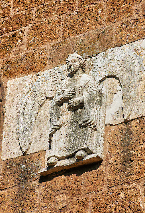 13th century angel sculptures on the facade of the Romanesque Basilica Church of Santa Maria Maggiore, Tuscania .<br /> <br /> Visit our ITALY PHOTO COLLECTION for more   photos of Italy to download or buy as prints https://funkystock.photoshelter.com/gallery-collection/2b-Pictures-Images-of-Italy-Photos-of-Italian-Historic-Landmark-Sites/C0000qxA2zGFjd_k