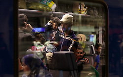 12.09.2015, Hauptbahnhof Salzburg, AUT, Fluechtlinge am Hauptbahnhof Salzburg auf ihrer Reise nach Deutschland, im Bild ein männlicher Flüchtling mit Kind im Zug // a male refugee with a child in the train. According to reports thousands of refugees fleeing violence and persecution in their own countries continue to make their way toward the EU, just days before Euopean leaders are set to meet in Brussels to discuss a solution to the arrival of so many people, Main Train Station, Salzburg, Austria on 2015/09/12. EXPA Pictures © 2015, PhotoCredit: EXPA/ JFK